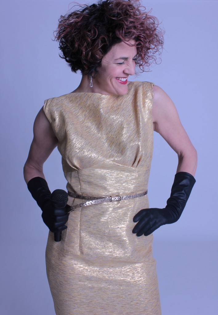 Vintage woven gold gown with black opera gloves.